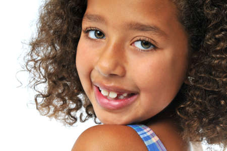 Portrait of beautiful biracial girl smiling isolated on white Stock Photo - 7796785