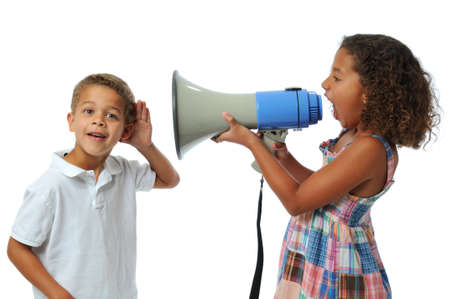 Girl screaming at boy using a megaphone isolated on white