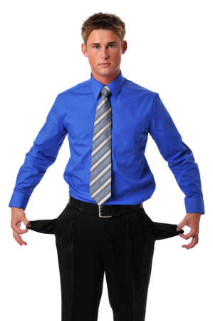 Young businessman showing empty pockets as a symbolism photo