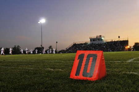 Football field at the 10th yard at night Stock Photo
