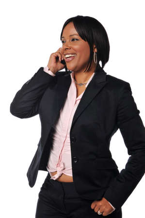 African American woman on the cell phone smiling against a white background Stock Photo - 7889295