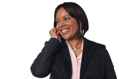 African American woman on the cell phone smiling against a white background Stock Photo - 7889283