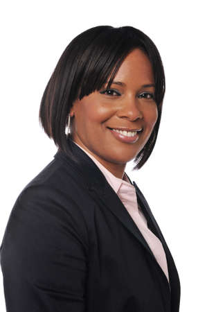 Black businesswoman portrait smiling against a white background