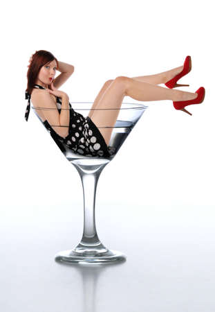 Young redheaded woman in a martini glass