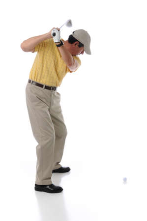 pga: Golfer teeing off in a studio setting isolated on a white background Stock Photo