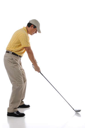 golf cap: Golfer teeing off in a studio setting isolated on a white background Stock Photo