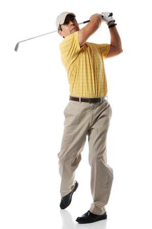 columpio: Golfista despu�s de swing en un ajuste de estudio aislado en un fondo blanco