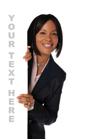 Black young businesswoman holding a blank sign isolated on white photo