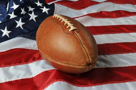 american football ball: Football againsta USA flag on a vertical format Stock Photo