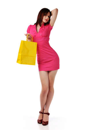 Redhead young woman fashion model with shopping bag isolated on a white background Stock Photo - 7961200