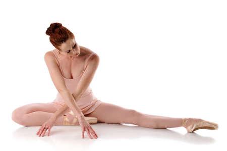 ballerina tights: Ballarina posing on the floor isolated on a white background Stock Photo