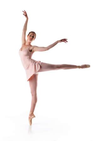 Ballerina uitvoeren van een dans tegen een witte achtergrond  Stockfoto