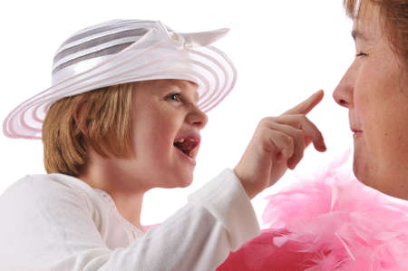 Special needs girl with mother playing isolated against a white background photo