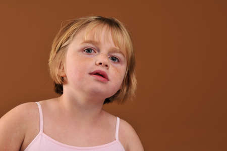 Special needs girl isolated against a brown background photo