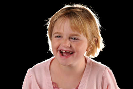 Special needs girl isolated against a black background photo