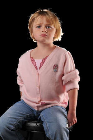 special needs: Special needs girl isolated against a black background