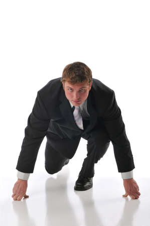 contestant: Businessman ready for a race isolated agains a white background Stock Photo