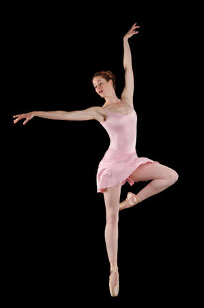 ballet tutu: Ballerina performing against a black background Stock Photo