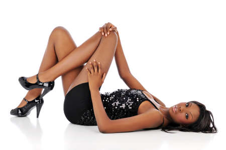 Young fashion african american woman posing and isolated against a white background photo