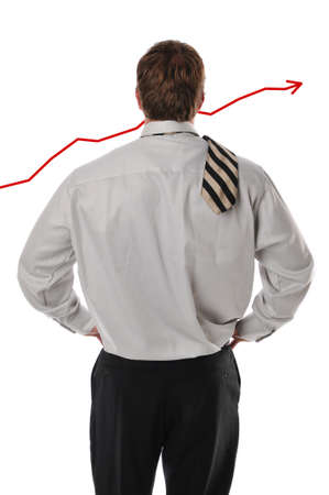 Businessman looking at chart isolated against a white background photo