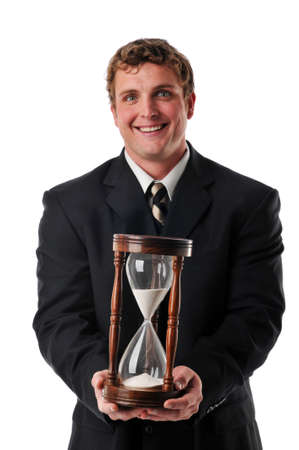 Businessman holding a sand timer isolated against a white background photo