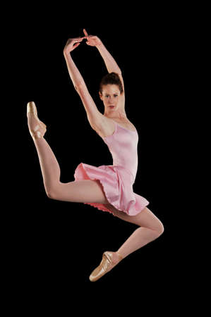 Ballerina performing against a black background photo