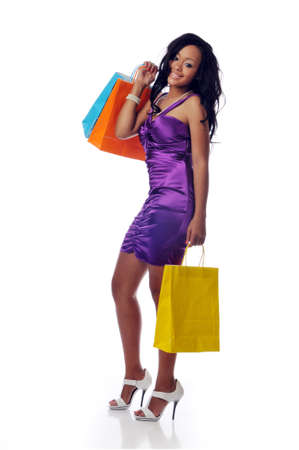 Young African American shopper isolated against a white background