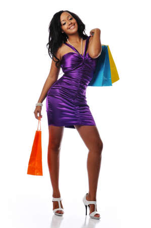 shopper: Young African American shopper isolated against a white background