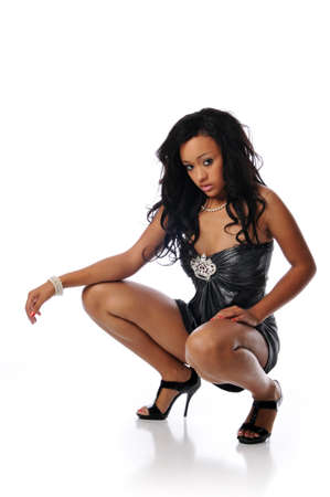 Young fashion african american woman posing and isolated against a white background Stock Photo - 7961509