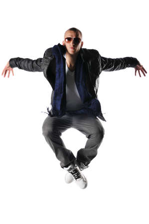 aerobica: hip-hop style dancer jumping against a white background