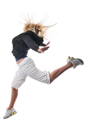 白い背景に対して実行する若い現代ヒップホップのダンサー