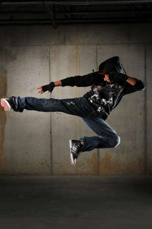 Hip hop dancer performing against a grunge wall Stock fotó