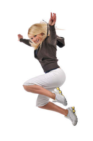 Young modern hip hop dancer performing against a white background