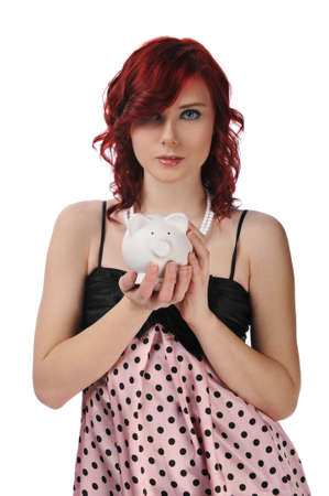 Woman holding a piggybank isolated against a white background photo