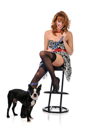 burlesque: Pin-up girl with a dog isolated against a white background