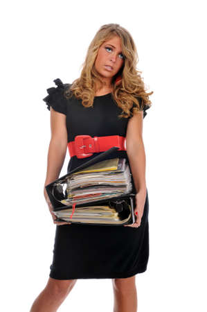 dismay: Overworked office worker holding a pile of files isolated against a white background