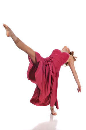 classical dance: Ballerina performing wearind a dress isolated against a white background