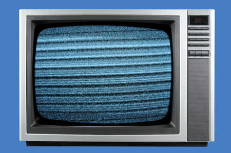 Vintage television isolated on a blue background Stock Photo - 7968237