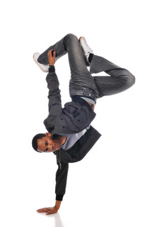 Hip Hop dancer performing against a white background