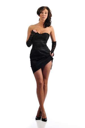 Fashion young woman wearing a black dress isolated against a white background