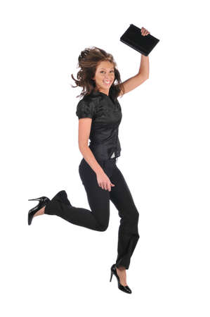 Businesswoman jumping and celebrating against a white backround photo