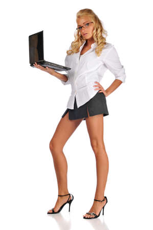 sexy secretary: Businesswoman holding her laptop isolated against a white background Stock Photo