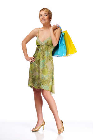 Young woman carrying shopping bags isolated on  a white background Stock Photo - 7961632
