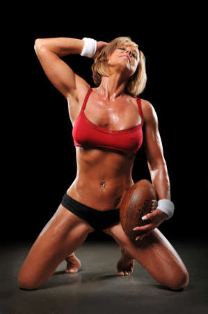 Woman with football after a workout photo
