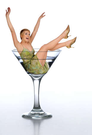 cocktail dress: Young woman in a martini glass expressing excitement isolated on white