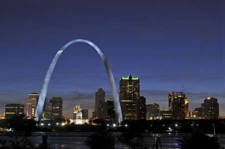 gateway arch: Saint Louis Skyline with the Mississippi river in front at night