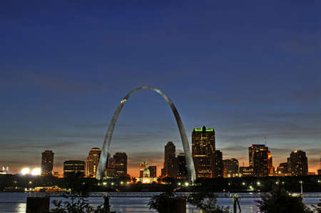 louis: Saint Louis Skyline with the Mississippi river in front after sunset
