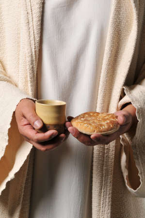 Jesus holding a bread and a wine as a symbol of communion photo