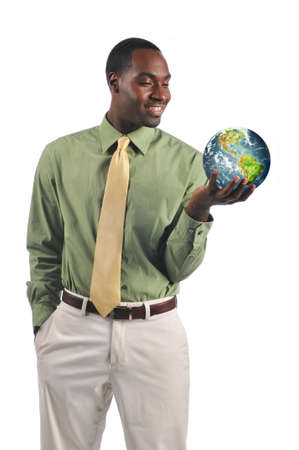 Black businessman holding the earth and smiling isolated on a white background