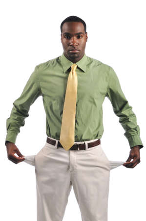 Young businessman showing empty pockets isolated on a white background photo